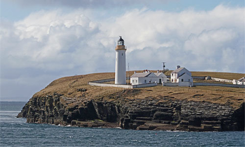 Cantick Head Lighthouse, Longhope, Orkney, Scotland, at juncture of Pentland Firth and Scapa Flow. Photo from ferry.